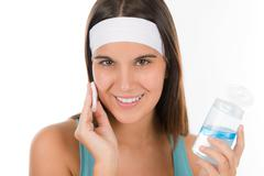 Teenager problem skin care - woman cleanse Stock Photos