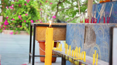 Candles and smoking prayer sticks Stock Footage
