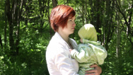 Stock Video Footage of Mother playing with baby in park
