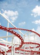 roller of coaster against blue sky. - stock photo