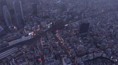 Aerial illuminated Shinjuku Skyscrapers Business District Rail Japan Stock Footage