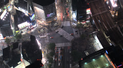 Aerial illuminated Shibuya scramble crossing people buildings Tokyo Stock Footage