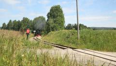 Steam Railroad steam locomotive passing by whistle blowing with old cars - stock footage
