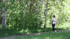 Mother walking with baby in park - stock footage