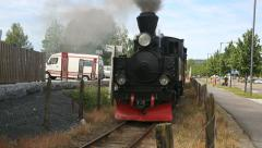 Steam Railroad steam locomotive passing by with old cars Stock Footage