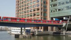 Canary Wharf DLR Train Coming In and Out of Station Stock Footage