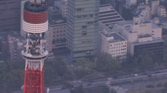 Stock Video Footage of Aerial Tokyo Tower close up dusk built structure Expressway Minato Japan