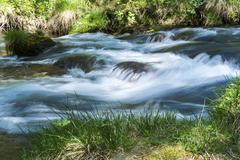 river in the forest of devero alp - stock photo