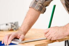 Home improvement - close-up of measuring wood Stock Photos