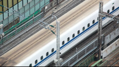 Above view of bullet train on a railtrack, Tokyo, Japan Stock Footage