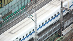 Above view of bullet trains on a railtrack, Tokyo, Japan Stock Footage