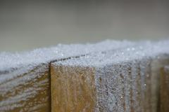 Wood covered with frost in winter - stock photo