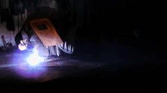 A worker welds in a old Workshop -  mystical atmosphere Stock Footage