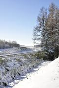 Winter landscape with one car on a motorway - stock photo