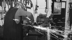 A worker grinding works - old film effect - black and white Stock Footage