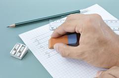Hand erasing a writed mistake - stock photo
