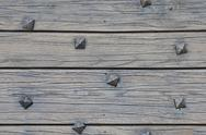 Stock Photo of Wood planks with square nails texture that perfectly loop