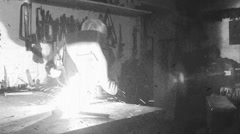 A worker welds - old film effect - black and white Stock Footage
