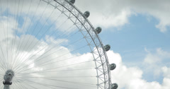 4K video of clouds passing over the iconic London Eye tourist attraction Stock Footage