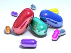 Capsules multicolored on a white floor Stock Illustration