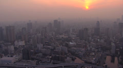 Stock Video Footage of Aerial Metropolis cityscape sunset Tokyo skyscraper built structure Japan Asia