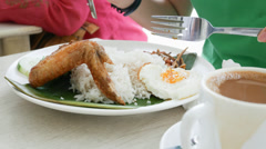 4k Ultra HD time lapse video on eating a plate of Nasi lemak(TL-MEAL 61) Stock Footage