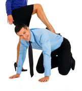 submissive businessman at work - stock photo