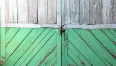 Green old wooden door with a lock on it Stock Footage
