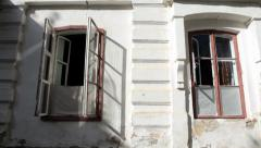 Old building with two open windows Stock Footage