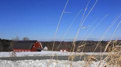 Red barn snowy field - stock footage