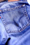 Fragment of blue modern jeans with pocket, can be used as a background. - stock photo