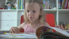 Little Girl Reading a Story Book at her Office, Child Studying, Learning to Read Stock Footage