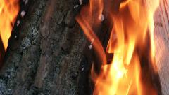 Wood burning in fire pit on a camp site Stock Footage