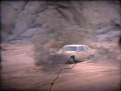 SUPER 8 USA 1979 cadillac driving in the desert 1/3 Stock Footage