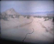 SUPER 8 USA 1979 cadillac driving in the desert passanger side 3/3 - stock footage