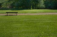 Stock Photo of park bench with green grass