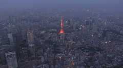 Stock Video Footage of Aerial Tokyo Tower illuminated skyline dusk built structure  Minato Japan