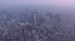 Aerial dusk Buildings Tokyo city skyscrapers Minato Business district Japan - stock footage