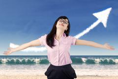Stock Illustration of carefree woman celebrating her success at beach