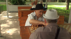 Old Men Playing A Chess Game, Elderly, Retired, Park, Still Shot Stock Footage