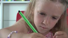Ultra HD 4K Little Girl Learning, Studying Drawing Animals in Book, Child Color Stock Footage