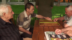 Old Men Playing Backgammon, Elderly, Retired, Park, Games, Paper News, Pan Shot Stock Footage