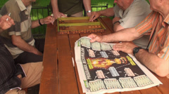 Old Men Playing Backgammon, Elderly, Retired, Park, Games, Paper News, Tilt Shot Stock Footage