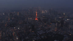 Aerial illuminated Tokyo Tower dusk city media skyline Tokyo Bay Japan - stock footage