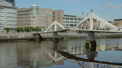 Tradeston or squiggly bridge over river clyde, glasgow, scotland Stock Footage
