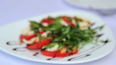 Dish of tomatoes and broccoli, sauce.Fresh vegetable appetizer. Stock Footage