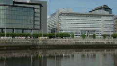 Pan of office buildings, over river clyde, glasgow, scotland Stock Footage