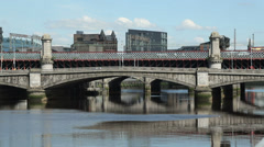 Train and traffic cross river clyde, king george v bridge, glasgow, scotland Stock Footage