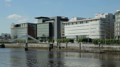 Office buildings along river clyde, glasgow, scotland Stock Footage