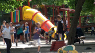 Stock Video Footage of Summer Time Playground Full With Kids Playing And Having Fun, Still Shot